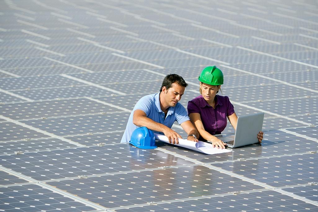 Engineers working on solar panels