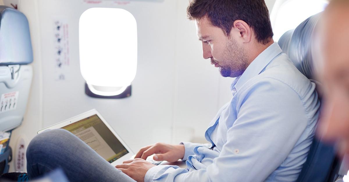 Man on plane on Tablet